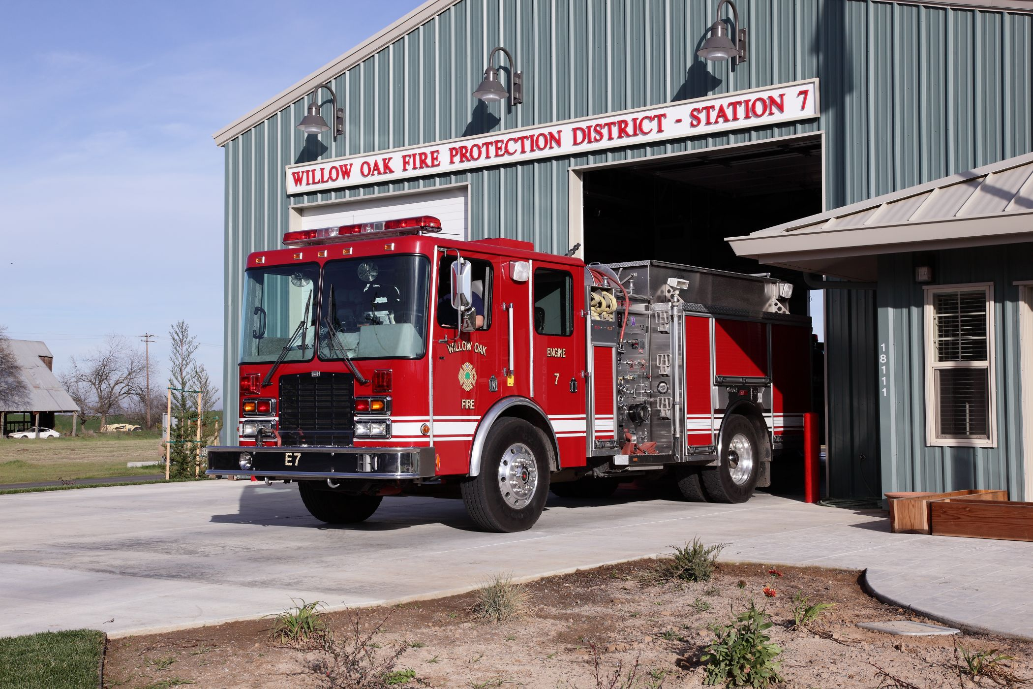 Outside view of fire station and trucks